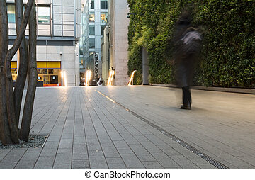 Urban street with people passing by in a city business area