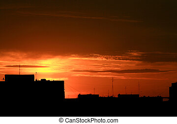 Red sunset in urban area