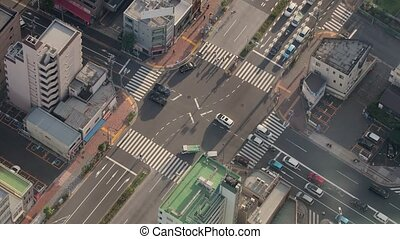 Urban traffic from above - Urban road intersection with...