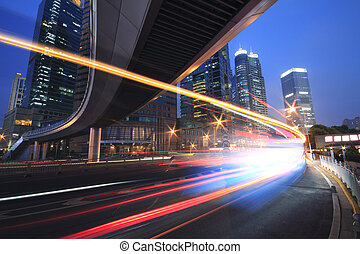 Urban viaduct traffic of car night with rainbow light trails...