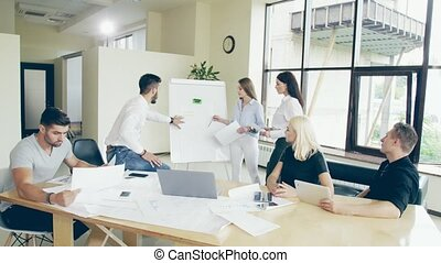 Urgent meeting in the office Team of young people clean up ...