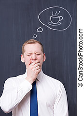 Urgent need of a solid coffee break - Yawning office worker...