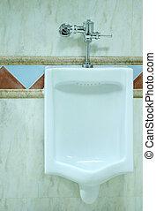 urinal in a men's restroom