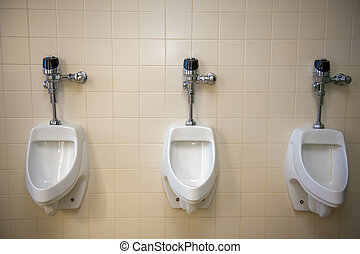 urinal in a rest room - A set of urinals in a restroom