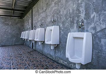 urinal row in a public restroom