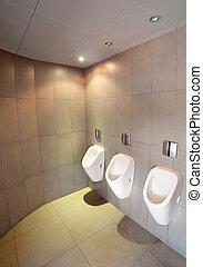 Few white urinals in men's toilet