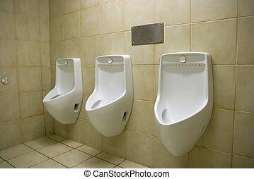 Urinals - Three urinals in a public toilet