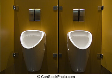 two urinals in a public restroom