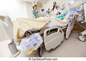 Urine Bag Attached To Bed - Urine bag attached to bed with...