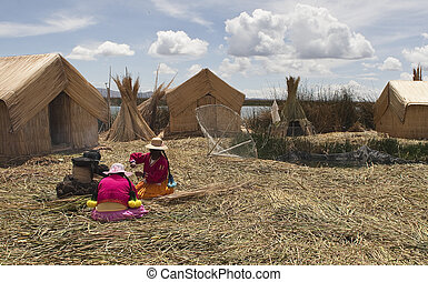 Amerindian women to cook fish. reed Uros Islands