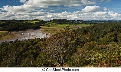 The view from the Muckle at Kippford or Scaur, Urr Water and yachts at the Quay can be seen in the bottom of the valley and in the distance Dalbeattie, Dumfries and Galloway.