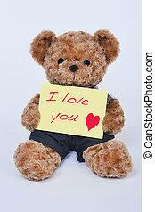 urso teddy, segurando, um, sinal amarelo