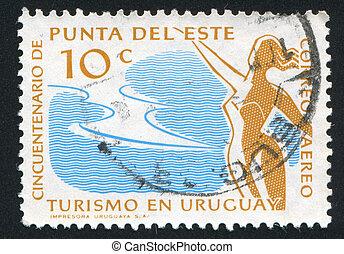 Girl at Seaside Resort - URUGUAY - CIRCA 1959: stamp printed...