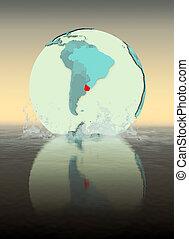 Uruguay on globe splashing in water