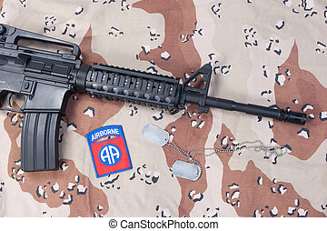 us airborne carbine with blank dog tags on desert camouflage uniform
