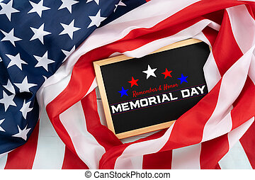 US American flag with blackboard on blue wooden background. For USA Memorial day. Top view with memorial day text.