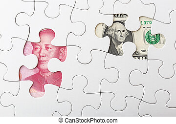 US and chinese yuan with white puzzle for exchange rate concept