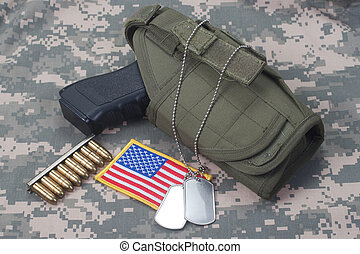 US ARMY concept with handgun on camouflage uniform