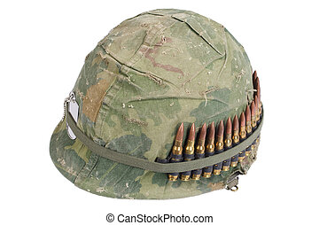 US Army helmet with camouflage cover and ammo belt and dog ...