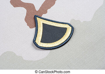 US ARMY Private First Class rank patch on desert uniform