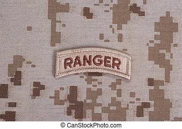 US ARMY ranger tab on camouflage uniform