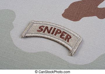 US ARMY sniper tab on camouflage uniform