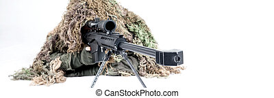 Army sniper wearing a ghillie suit