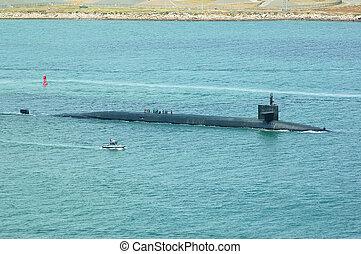 U.S. Ballistic Missile Submarine with a Patrol Boat Escort.