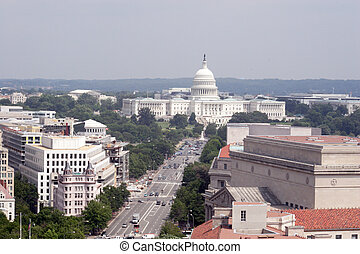 An elevated view of the U.S. capital building as seen from the old post office bell tower. A wonderful view of the building and the surrounding town.