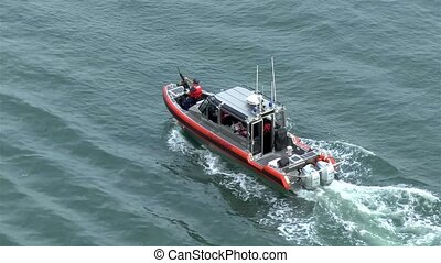 A US Coast Guard patrol boat provides security to departing cruise ships in Port Canaveral, Florida.