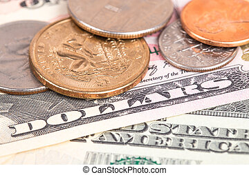 US coins on US banknotes close up
