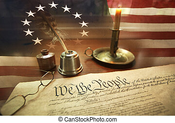 US Constitution with quill pen, glasses, candle, ink and ...