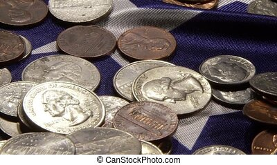 American money coins laying on United States flag - Financial security concept
