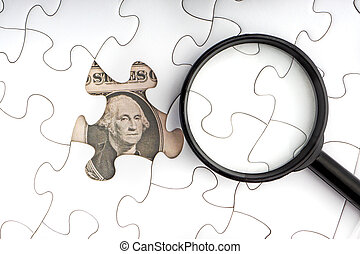 US Dollar banknotes and magnifying glass on white jigsaw puzzle. Copy space concept