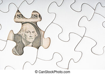 US Dollar banknotes on white jigsaw puzzle. Copy space concept