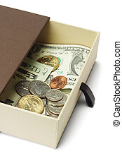 US dollar notes and coins in gift box