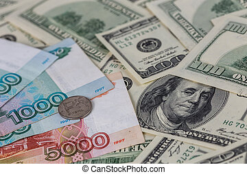 us dollars and russian rubles close-up background with selective focus
