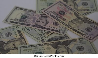 US dollars falling on table of different denominations