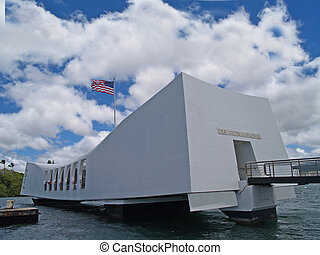 US Flag flying above the USS Arizona Memorial in Pearl Harbor, Honolulu, Hawaii.