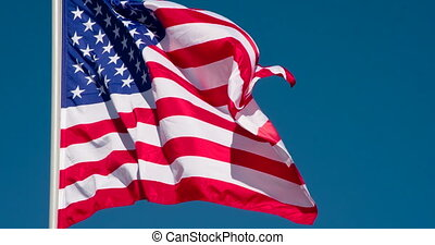 US flag Against the Sky - The Big State Flag is illuminated...