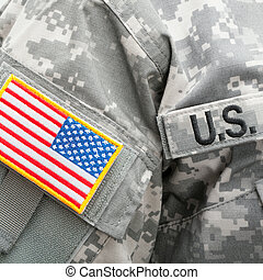 US flag and U.S. ARMY patch on military uniform - studio shot