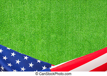 US flag border on artificial green grass background
