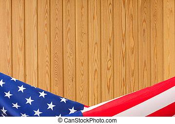 US flag border on wooden background