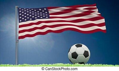 US flag fluttering and football rolls - Flag of United...