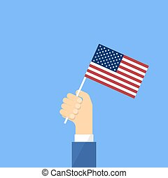 US flag in hand