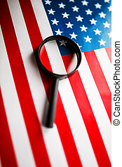 US flag looking through a magnifying glass. Study of the history and culture of the country of the United States. The concept of studying geography, English and customs