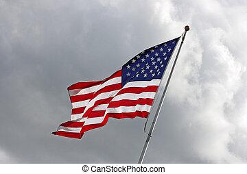 US Flag over cloudy sky