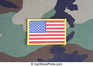 US flag patch on woodland camouflage uniform