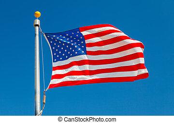 US Flag over blue sky