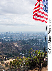 US flag with Los Angeles on the background